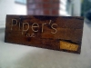 pipers-pub-mill-street-sign